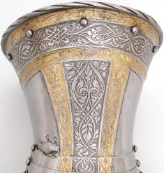 A pr of Gauntlets belonging to  an armor of Philip ll of spain  German Augsburg 1540