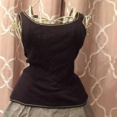 Ann Taylor 100% silk knit top Great alone or with a cute little jacket like my black and red floral this little shell is a perfect wardrobe staple. Ann Taylor Tops Tank Tops