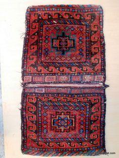 KURDISH SADDLE BAGS A rare semi-antique inscribed pair