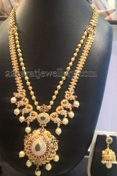 Small gold balls and peacock layers of long chain with two step design ruby and CZ pendant, studded with small pearls hanging acros. Gold Pendent, Pendant, Sterling Necklaces, Gold Jewellery Design, Gold Jewelry, Engraved Necklace, Schmuck Design, Necklace Designs, Indian Jewelry