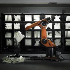 This interactive installation by design studio Kram/Weisshaar allows users to remotely control a robotic arms that sculpt foam cubes into furniture pieces