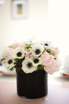 Love this painted black paint can of flowers Flowers For You 7ce7ab4b694