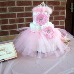 Pink and brown baby shower!!! Diaper cake decorated with a tutu, headband, and a tiara!