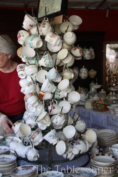 Tea Cup Tree: Brimfield Antique Show ... nice idea to display open sugar bowls and creamers too!
