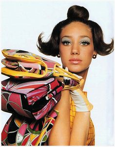 Holding Emilio Pucci bags, photo by Irving Penn 1965