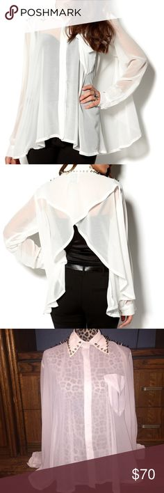 """UNIF White """"Caution"""" Sheer Metal Alternative Top M UNIF """"CAUTION"""" SHEER BLOUSE   Size: MEDIUM  CONDITION: Pre-owned; no missing embellishments   DESCRIPTION: Big spikes are hanging out on the shoulders and collar of this top. There's a front pocket and buttons that go all the way down the front. The back is open in the shape of a V turning this top into a super drapey cape. (AS PHOTOGRAPHED). No smells, stains, rips, tears, or holes. IF YOU HAVE ANY QUESTIONS PLEASE FEEL FREE TO MESSAGE ME…"""