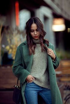 Nisi is wearing: Céline Trio Bag, Green Acne Studios Coat, Turtleneck Sweater, Topshop Girlfriend Jeans and Jimmy Choo Tide Sling-back Pumps