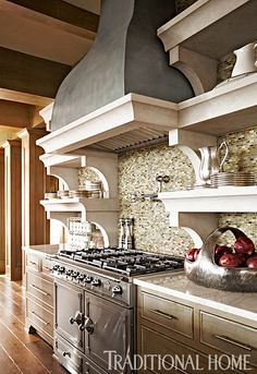 A custom pewter hood tops the La Cornue range in this cool kitchen. - Photo: Colleen Duffley / Design: Susan Bohlert Smith