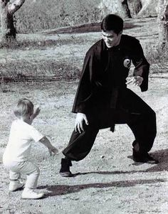 Bruce Lee and young Brandon. Watch and learn - and adults be aware of what you are doing and how you are doing it, because children want to copy you.