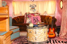 our own JuNK Gypsy airstream, amie's and indie's little love shack! designed especially for mama and daughter. . .  biggo gorgeous drum turned into a table.