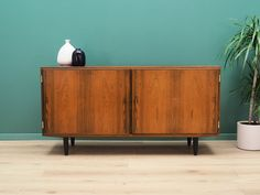 Cabinet was made in the 60s and was produced by the well-known Danish manufactory Hundevad. It was designed by a leading Danish designer Carlo Jensen. Buffet Teck, Teak Sideboard, Danish Design, Sliding Doors, Designer, Solid Wood, Shelves, Storage, Interior