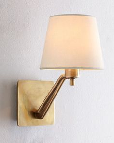 """Brass Sconce by AERIN at Horchow. AERIN Brass Sconce Designed by Aerin Lauder exclusively for Visual Comfort. Handcrafted of brass with a hand-rubbed antiqued brass finish. Natural linen shade. Uses one 60-watt bulb. 7""""W x 10.75""""D x 12""""T with 5.25""""Sq. back plate."""