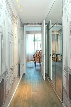 sleek hallway with trompe l'oeil wallpaper