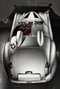 silver 1953 Jaguar XK120. This was a fun time for auto styling! Humps and bumps everywhere!