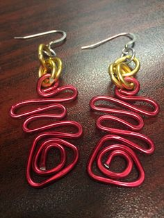 A personal favorite from my Etsy shop https://www.etsy.com/listing/264833192/red-and-gold-earrings-swirl-earrings