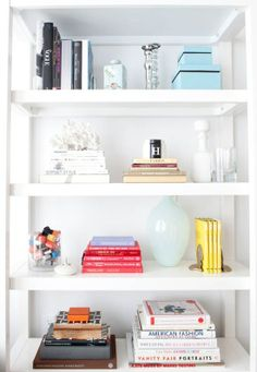 Mix books with decorative objects, it will solve that monotony of rows.