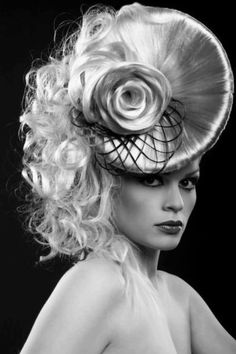 A lot of hairstyles on one head... including a fascinator!