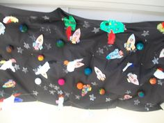 Outerspace on the ceiling of classroom...black table cloth, sponge paint stars, rockets with their pics in the window, and aliens (fold white paper in half, put a blob of green paint in fold and press down on crease..let dry cut out and decorate with lots of eyes, feathers, etc.)