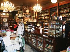 Haworth's Old Apothecary Shop  We could simulate this type of thing, but small scale for teh bar area. Ie. vintage cocktail area (spirits and mixers in un-labelled bottles, staff trained to know whats in what, and so they can mix up a personal 'tonic' when guests arrive?