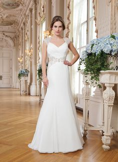 Lillian West Style 6340 Chiffon, embroidered lace, beaded appliques fit and flare dress accented with a Queen Anne neckline.