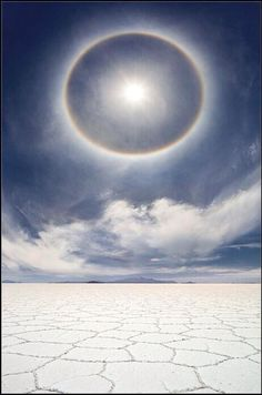 A very rare and beautiful photo of a circular rainbow over the salt marshes of Bolivia Destination.
