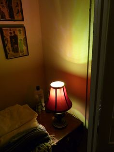 """My """"Autumn Light,"""" casting a fanciful glow on the wall and retro clothing ads in the room where I stayed for 3-1/2 weeks at Noel and Mary Catherine's place in Charleston while I did obsessive repairs and little art projects and looked for a new place to live."""
