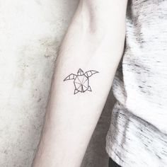Graphic Black Turtle Tattoo On Lower Arm
