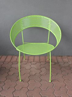 this colorful metal chair in powder coated lime green brings spunk + hue anywhere you place it. perforated holes + its round shape add visual texture; we love these chairs around a dining table, in front of a desk or on the back patio. pair with its matching sunshine table for striking appeal.