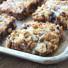 These Seven Layer Magic Bars are always a huge hit when I take them to parties! They literally disappear within minutes every time!