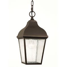 Lend and inviting glow to your covered patio or porch with this contemporary hanging lantern-style pendant. Finished in classic oil-rubbed bronze and accentuated by seeded glass panels, outfit your outdoor space with this transitional one-light pendant.