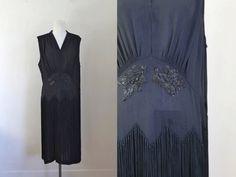 vintage 1920s fringed dress - BLACKBERRIES black beaded flapper dress / L by MsTips on Etsy https://www.etsy.com/listing/258277550/vintage-1920s-fringed-dress-blackberries