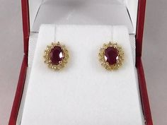 Ruby and Diamond Earrings. Cluster/Halo Style by RitzJewelers @RitzJewelersLA (213) 624-7664 or RitzJewelersLA@gmail.com