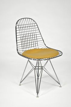 Artist/Designer: Charles and Ray Eames b. Charles 1907-1978, St. Louis Ray 1912 - 1988, Sacramento Title: Wire Side Chair with Seat Cushion (DKR) Medium: Chrome plated metal wire, upholstery Dimension
