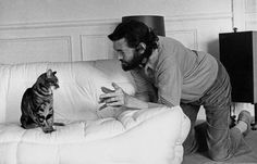 Julio Cortázar and his tabby cat.