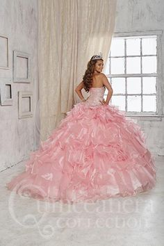 Ruffles of tulle are speckled with small clear stones on this gorgeous design, notable for its dense clusters of beads all throughout the bodice. Download the Quinceanera Collection by House of Wu siz