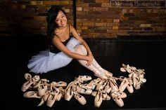 Senior Photography. Save all the pointe shoes from start till end of senior year and take a ballet photography with them. I think this would be neat with a standing pic with the shoes strewn all over the ground.