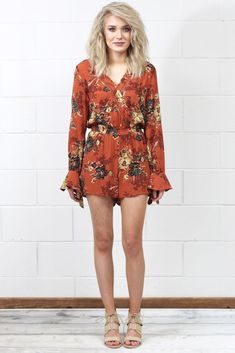 We love rompers and this long sleeve one is perfection! Features a gorgeous vintage floral print over a somewhat lighter rust color. Sleeves tie at the wrist. Elastic waistband. Shorts are fully lined. Great length for tall girls.
