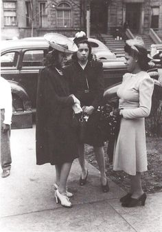 Some extra fabulous African American women dressed to the nines and chatting c.1940's. OMG. Check out the SHOES, not to mention those hats...