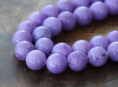 Hey, I found this really awesome Etsy listing at https://www.etsy.com/listing/102268876/mountain-jade-beads-lavender-8mm-round