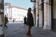 Fashion blogger Veronika Lipar of Brunette From Wall Street sharing how to style the floral bomber jacket and floral skater skirt with over the knee boots