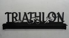3D Triathlon Medal Holder by IronSportWorks on Etsy, $60.00