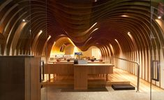 Cave, Sydney by Koichi Takada  The Cave is cocooned in a series of undulating wooden ribs, which dip over the seating area