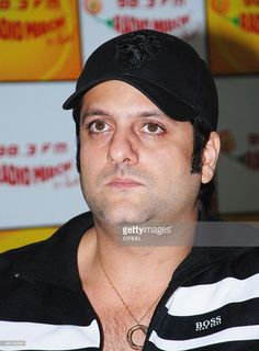 Indian cinema actor Fardeen Khan poses during a promotional visit to Radio Mirchi to promote the film 'Life Partners' in Mumbai late August 10, 2009.