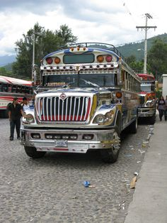 Buses lined up near the terminal in Antigua, Guatemala