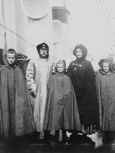 The Imperial Family in their raincoats