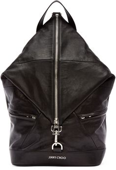 Unstructured buffed leather backpack in black. Carry handle at top. Adjustable shoulder straps. Zip closure with lanyard fastening at main compartment.  Zippered pockets and logo plaque at bag face. Zippered pocket at bag interior. Textile lining. Silver-tone hardware. Tonal stitching. Approx. 12.5