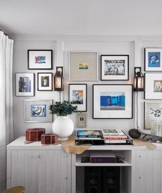 Buy frames with precut mats first, then print out favorite images to fill them at whatever size you need.