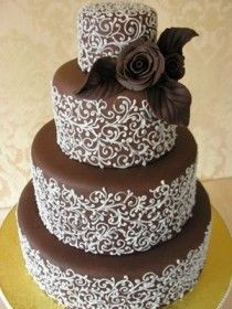 Chic chocolate wedding cake with edible rose.  Dream Wedding and Event Planners will assist you in locating the perfect cake designer. Go to www.DreamWeddingPlanners.com