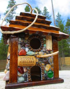 Rustic Star Birdhouse ready to hang by WinestoneBirdhouses. Beads, stones, wine corks and walnut.