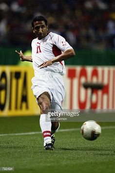 Adel Sellimi of Tunisia passes the ball during the FIFA World Cup Finals 2002 Group H match between Belgium and Tunisia played at the Oita Big Eye...